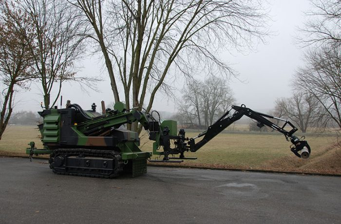 A75T (SDZ) with Backhoe extended to reach UXO
